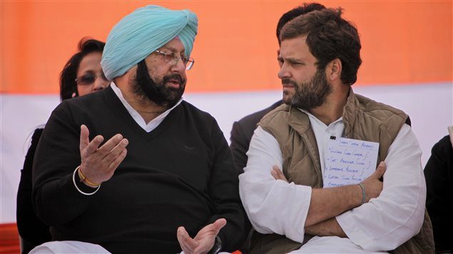 India's ruling Congress party leader Rahul Gandhi, right, speaks with then former chief minister of Punjab state Captain Amarinder Singh during an election rally at in Chabal some 30 kilometers (19 miles) from Amritsar, India, Wednesday, Jan. 25, 2012.