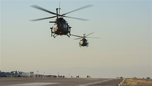 Two CH-146 Griffon helicopters take off from the flight line near Camp Érable, Iraq during Operation IMPACT on February 20, 2017.