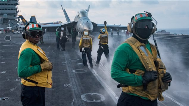 Sailors conduct flight operations on the aircraft carrier USS Carl Vinson (CVN 70) flight deck, in the South China Sea April 8, 2017.