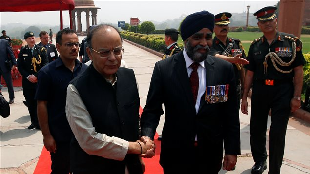 Canada's Defence Minister Harjit Sajjan shakes hands with his Indian counterpart Arun Jaitley (L) after his ceremonial reception in New Delhi, India April 18, 2017