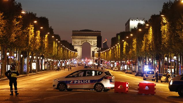 Police secure the Champs Elysee Avenue after a shooting incident in Paris, France.