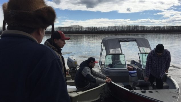 Volunteers in about 30 boats have gone out on the Rocher River every day for a week, searching for four hunters who went missing last Sunday. (Mitch Wiles/CBC)