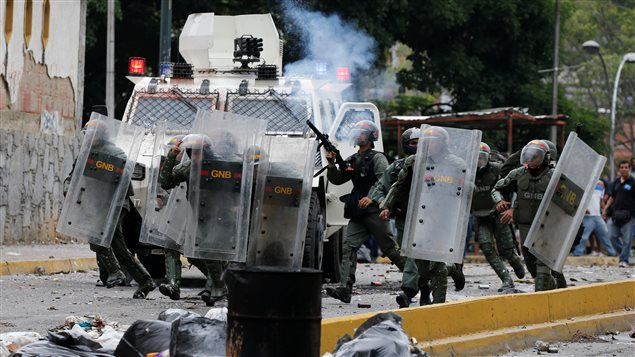 Venezuelan National guards fire tear gas toward opposition supporters during a protest against Venezuela's President Nicolas Maduro's government in Caracas, Venezuela May 2, 2017.