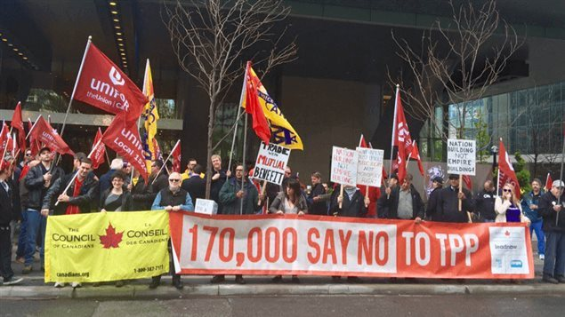 May 2016: Members of the Unifor trade union and the Council of Canadians join to protest TPP outside a luxury Toronto hotel where the House of Commons standing committee on international trade was holding a 1-day hearing into the 12-country 'free trade' deal. The 170,000 were the number of names on an anti-TPP petition to that date