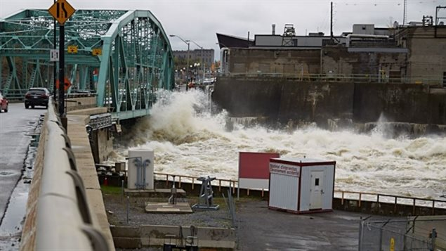 Surging water breaches the Chaudière Bridge SUnday, May , 2017 that connects Gatineau to as floodwaters continue to rise.
