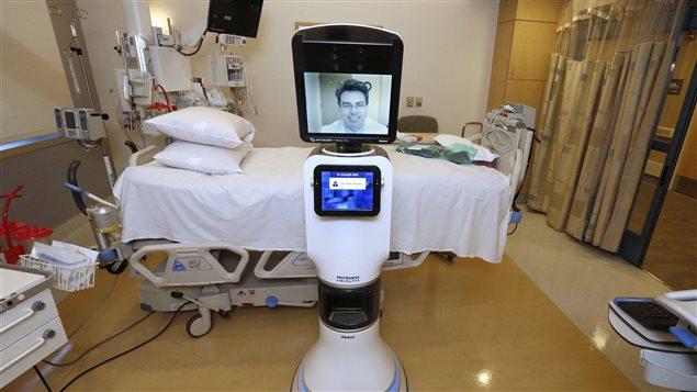 In this photo taken Wednesday, Nov. 6, 2013 Dr. Alan Shatzel, medical director of the Mercy Telehealth Network, is displayed on the monitor RP-VITA robot at Mercy San Juan Hospital in Carmichael, Calif.