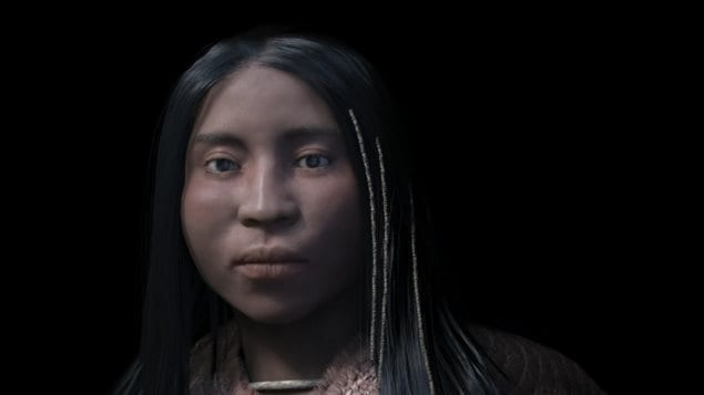 The reconstruction of a shíshálh woman shows beads woven into her hair.