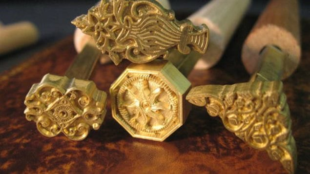 Some of the intricately carved *stamps* McGucking hand makes to recreate the intricate orginal patterns pressed in gold leaf into bindings.