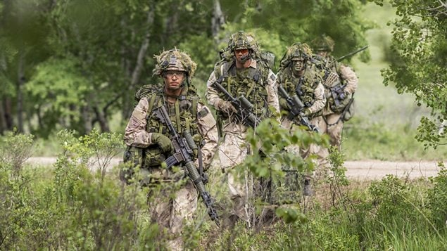 Members of 1st Battalion, The Royal Canadian Regiment, dressed as enemy force patrol the area during Exercise MAPLE RESOLVE in Wainwright, Alberta, on 1 June, 2016.