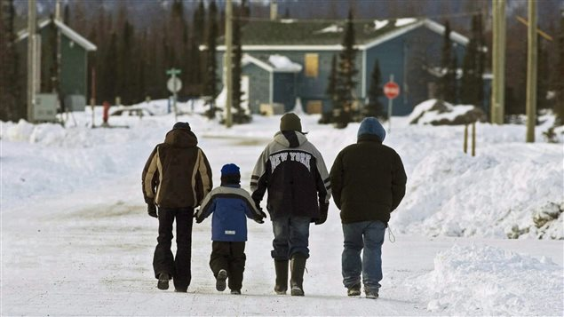 Residents walk in the northern Labrador community of Natuashish, N.L. on Thursday, Dec. 6, 2007.
