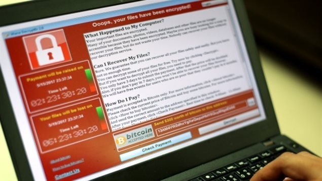 A message from this weekend's ransomware attack is seen on laptop in Taipei, Taiwan, on Saturday. Companies and government services in dozens of countries were affected by the attack, including the U.K., Germany, China, Japan and South Korea.