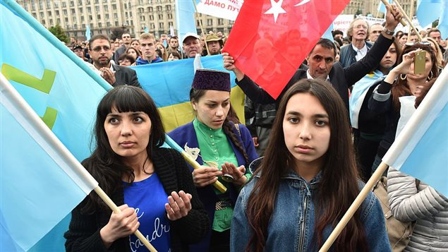 Crimean Tatars participate in a memorial ceremony on the Independence square in Kyiv on May 18, 2016 in commemoration of the 72nd anniversary of the deportation of the indigenous population of the Crimea by the Soviet Union.