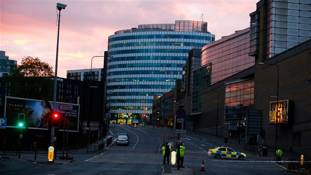 The sun rises as police stand guard outside the Manchester Arena in Manchester, Britain May 23, 2017.