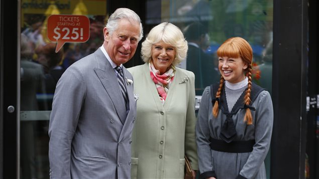 Britain's Prince Charles, and Camilla, Duchess of Cornwall, stand beside a woman dressed the character *Anne of Green Gables* in Charlottetown, Prince Edward Island, May 20, 2014.