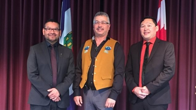Minister of Education, Culture and Employment Alfred Moses (left), N.W.T. MP Michael McLeod (centre), and Nunakput MLA Herbert Nakimayak (right) at a news conference Friday. (Gabriela Panza-Beltrandi/CBC)