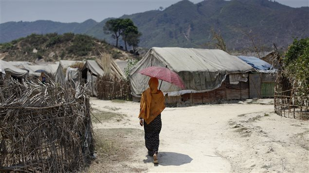A Rohingya woman walks at the Kyein Ni Pyin camp for internally displaced people in Pauk Taw, Rakhine state, April 23, 2014