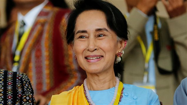 Myanmar State Counsellor Aung San Suu Kyi smiles as she attends a photo opportunity after the opening ceremony of the 21st Century Panglong Conference in Naypyitaw, Myanmar May 24, 2017.