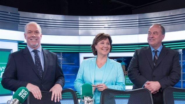 (L-R) B.C. NDP leader John Horgan, Liberal Leader Christy Clark and B.C. Green Party leader Andrew Weaver pose for a photo following the leaders debate in Vancouver, B.C., Thursday, April 20, 2017. The Liberals won the May election with a slim majority of seats, but NDP and Greens have formed a coalition which would give them one seat more than the Liberals.