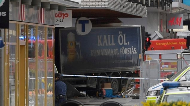 The rear of a truck, left, protrudes from a department store in central Stockholm, Sweden, on April 7, this year after plowing down the street killing four people and injuring 15.