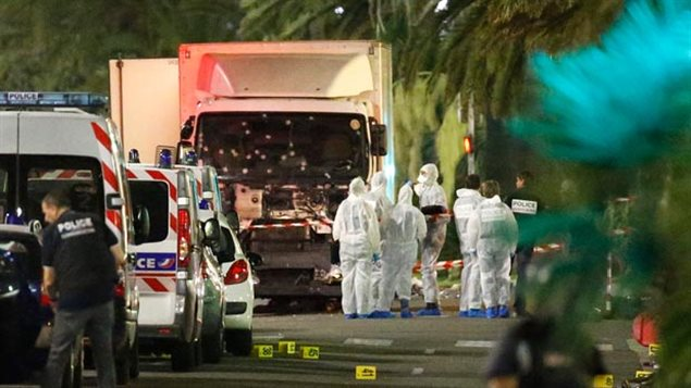 Forensic experts examine the bullet-riddled truck driven by a radical that drove into a crowd in Nice France on Bastille Day 2016, killing dozens.