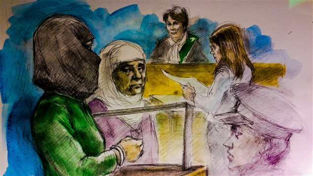 From left to right: Rehab Dughmosh, Arab interpreter, Justice of the Peace Alice Napier and Crown attorney Candice Suter at College Park courthouse in Toronto on June 6, 2017