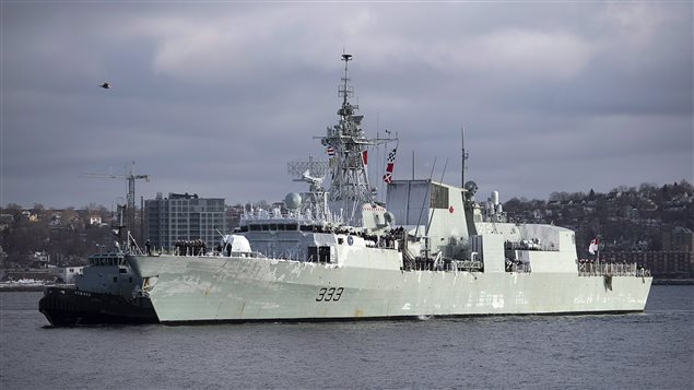Royal Canadian Navy frigate HMCS Toronto is guided by tugs to berth in Halifax on Sunday, Jan. 18, 2015. The new defence policy intends to fund the construction of 15 advanced warships to eventually replace the current patrol frigates.
