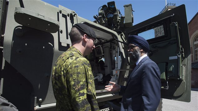 Minister of National Defence Minister Harjit Sajjan speaks with Cpl.Kevin Huard following the announcement of the Canadian Defence Review in Ottawa, Wednesday, June 7, 2017.