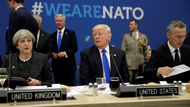 U.S. President Donald Trump (C) is flanked by British Prime Minister Theresa May (L) and NATO Secretary General Jens Stoltenberg during in a working dinner meeting at the NATO headquarters during a NATO summit of heads of state and government in Brussels, Belgium, May 25, 2017.