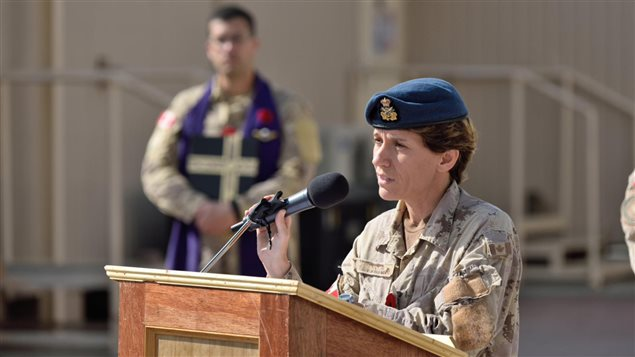 Brigadier-General Lise Bourgon, Commander Joint Task Force - Iraq, addresses the Remembrance Day parade in Kuwait on November 11, 2015 during Operation IMPACT.