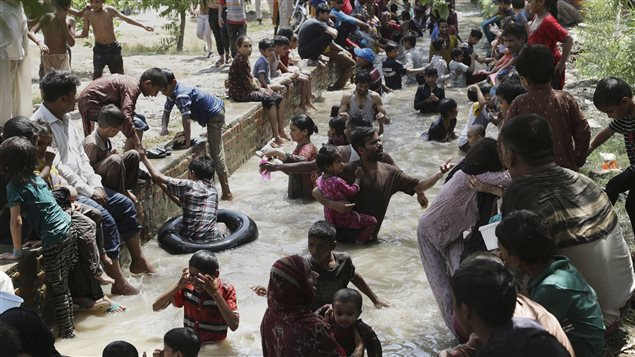 On June 4, 2017 families cooled off in a stream in Lahore, Pakistan.