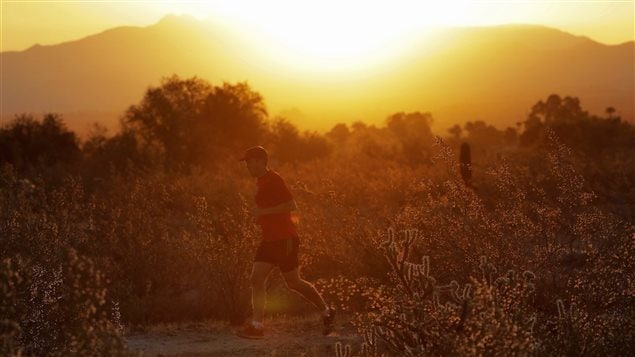 Runners get out early in the morning to beat the heat in Phoenix, Arizona. A heat wave is expected in that state, Nevada and California.