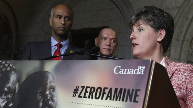 Minister of international Development Marie-Claude Bibeau (right) talks with reporters as Minister of Immigration , Refugees and Immigration Ahmed Hussen (left) and President of Red Cross Canada Conrad Sauve (centre) look on in Ottawa, Monday, May 29, 2017.