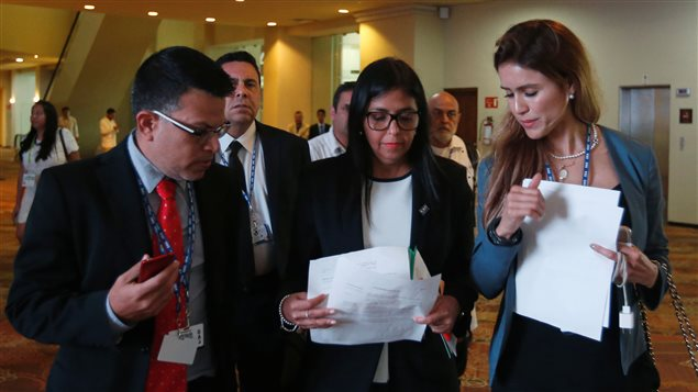 Venezuelan Foreign Minister Delcy Rodriguez (C) checks some documents with the delegation after a meeting with foreign ministers ahead of the OAS 47th General Assembly in Cancun, Mexico, June 19, 2017.