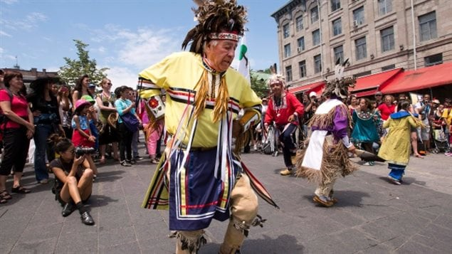 Mohawk Sonny Diabo, from Kahnawake, a reserve near Montreal, performs a smoke dance in Old Montreal as part of National Aboriginal Day, Friday, June 21, 2013, in Montreal.