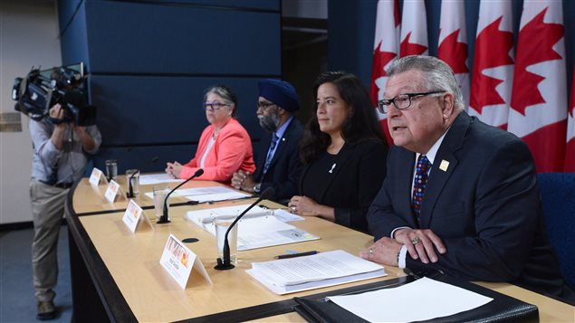 Public Safety Minister Ralph Goodale (right) and other cabinet ministers present new legislation to amend the controversial anti-terrorism law.
