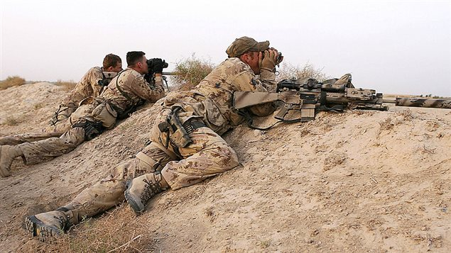 A Canadian sniper team scan the landscape during an Afghan-led operation to arrest suspected Taliban operating in the Panjwayi district of southern Kandahar province, supported by Coalition forces, 28 April 2006. Three Afghan police were killed, while security forces shot dead two Taliban rebels in separate incidents 29 April in southern Helmand province, officials said.