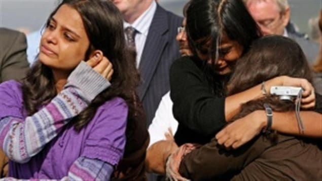 Relatives of Air India victim Anjani Kumar Sinha, from left, Geetika, Aarushi and Nivedita Srivastava, react to a June 23 service at a memorial in Ahakista, Ireland, to mark the 25th anniversary of the crash. A minute's silence was broken by chanting from the families at 8:13 a.m. — the moment a bomb exploded in a suitcase on Air India Flight 182, killing all 329 passengers and crew on board.