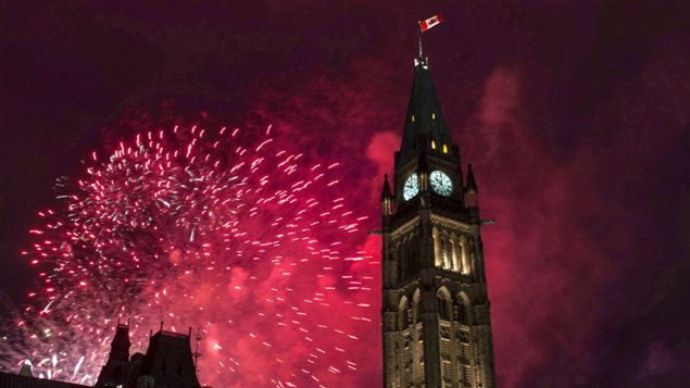 Fireworks explode behind the Victory and Peace Tower on Parliament Hill in the national capital, Ottawa, during Canada Day celebrations on July 1, 2015.  What's great about Canada? Canadians answers are as diverse as the country it seems