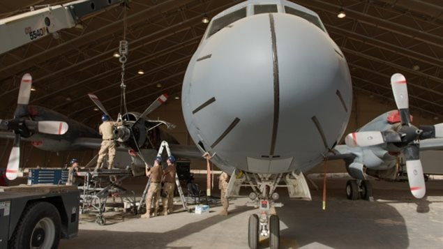 Servicing a Canadian CP-140 patrol plane, in 2015. Unionised defence workers say the new government policy will give private firms unprecedented access to DND operations. They fear the naval contract is just the start, and with proprietary new technology potentially keep them from being able to service or repair some equipment which could threaten operations, and contractors could charge higher fees being the only one to service equipment.
