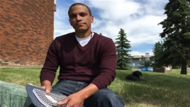 Matthew Hamm with the journals he wrote in while in solitary confinement for 43 days at the Edmonton Institution from June 30, 2016 to Aug. 10, 2016.