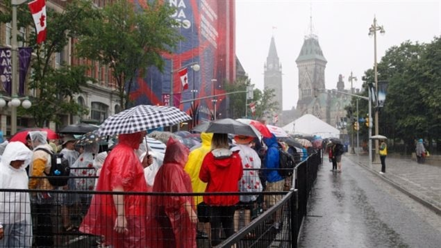 Members of the public wait in line to go through security screening before being allowed onto Parliament Hill on Canada Day in Ottawa on Saturday, July 1, 2017.