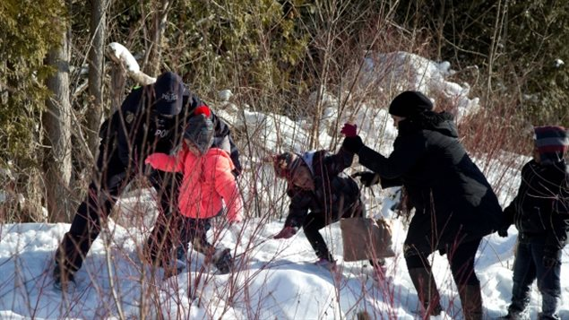 Police officers helped refugee-claimants who walked across the U.S.-Canada border in February to circumvent terms of the Safe Third Country Agreement.