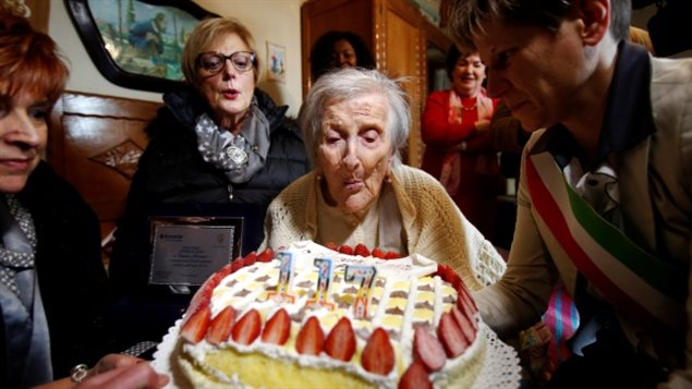 Emma Morano, thought to be the world's oldest person and the last to be born in the 1800s, blows out candles during her 117th birthday in Verbania, northern Italy, Nov. 29, 2016.  She passed away in 2017.