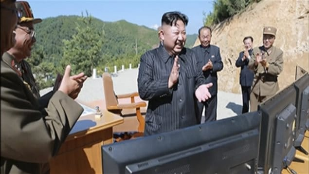 Image taken from state video of North Korean leader Kim Jong-un applauding the launch of the intercontinental ballistic missile. No independent journalists had access to the event.