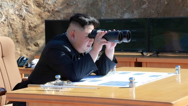 A photo from a North Korean news agency shows leader Kim Jong-un watching the test firing of an intercontinental ballistic missile on July 4, 2017.