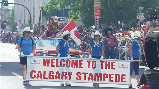 Many thousands of people lined up on Friday for the event opening Calgary Stampede parade in downtown Calgary