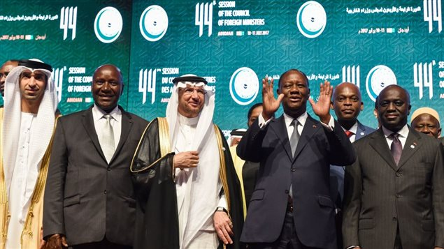 (From 2ndL) Ivory Coast Vice-President, Daniel Kablan Duncan (2ndL), Secretary-General of the Organisation of Islamic Cooperation (OIC), Yousef bin Ahmad al-Othaimeen , Ivory Coast President Alassane Ouattara and Ivory Coast Foreign Minister, Marcel Amon-Tanoh pose for a group photo at the opening of the 44th meeting of the Ministers of Foreign Affairs of the Organisation of Islamic Cooperation (OIC) on July 10, 2017 in Abidjan.