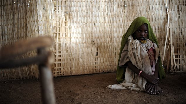 A young woman sits on the floor as she waits to receive medical help at the outpatient unit of a medical center run by Médecins Sans Frontières (MSF) (Doctors without Borders) in the town of Kuyera, in Ethiopia on September 4, 2008.