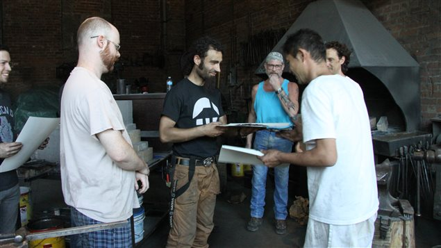 Master Japanese swordsmith Fusataro (R) presents Montreal-based blacksmith Ivan Savchev with his certificate of completion of a recent blade-making workshop at Les Forges de Montreal.