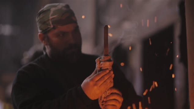 A still image taken from a promotional video by Iron Den Forge of a blade-making workshop organized by Allen Rozon and master Japanese swordsmith Fusataro.